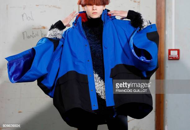 A model presents a creation by Junya Watanabe during the 2018/2019 fall/winter collection fashion show on March 3 2018 in Paris