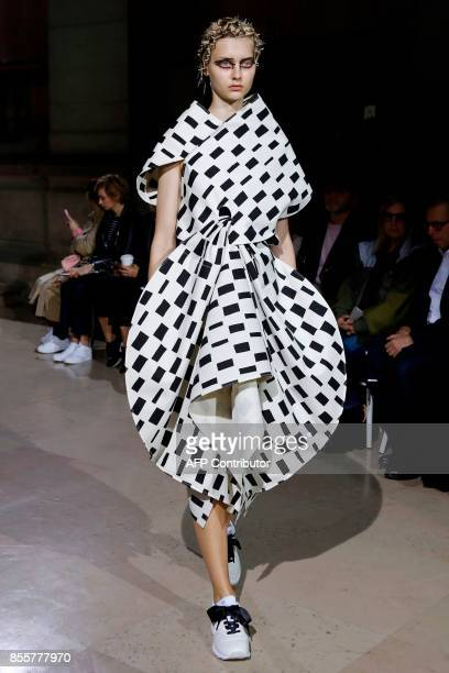 Model presents a creation by Junya Watanabe during the women's 2018 Spring/Summer ready-to-wear collection fashion show in Paris, on September 30,...