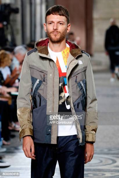 Model presents a creation by Junya Watanabe Man during the Men's Fashion Week for the Spring/Summer 2018 collection on June 23, 2017 in Paris. / AFP...