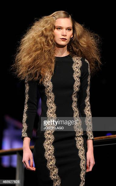 A model presents a creation by Justicia Ruano during the 080 Barcelona AutumnWinter 20142015 fashion week in Barcelona on January 30 2014 AFP PHOTO/...