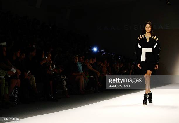 A model presents a creation by Kaal Eisuktae at the Concept Korea runway show during the MercedesBenz Fashion Week Spring 2014 collections on...