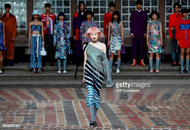 A model presents a creation by Kenzo during the Men's Fashion Week for the Spring and Summer 2018 collection in Paris on June 25 2017 / AFP PHOTO /...