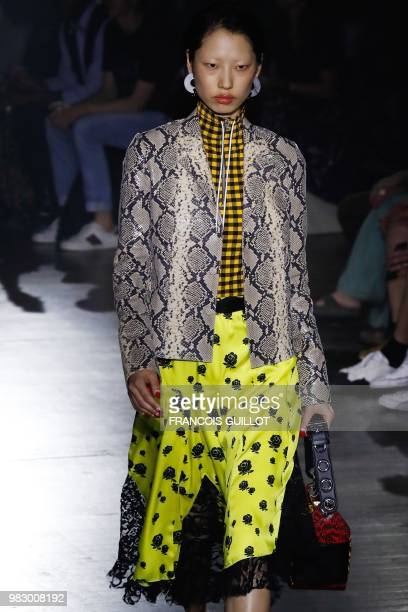 A model presents a creation by Kenzo during the men's Spring/Summer 2019 collection fashion show on June 24 2018 in Paris