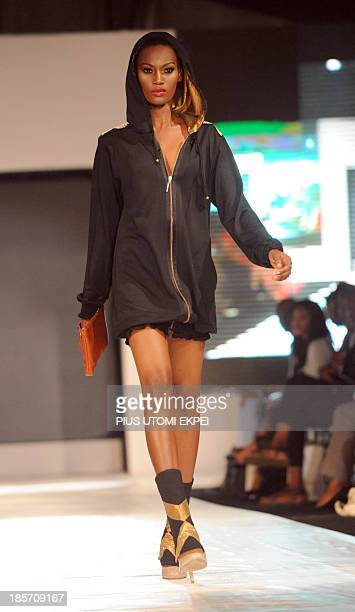 A model presents a creation by Kinabuti during the Lagos Fashion and Design Week on October 23 2013 The fourday Lagos Fashion and Design Week...
