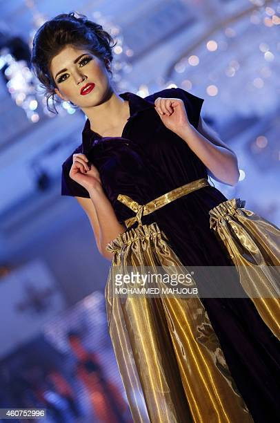 A model presents a creation by Kuwaiti fashion designer Nora Alhdhiran during the Gulf's Forum of Elegance event on December 21 2014 in the Omani...