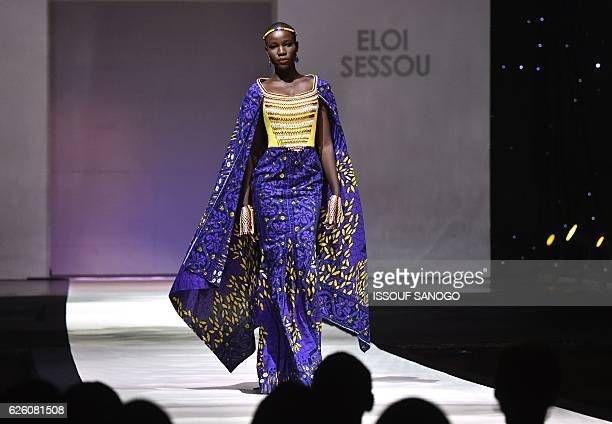 A model presents a creation by label Eloi Sessou during a fashion show marking the 170th anniversary of Dutch manufacturer of African luxury VLISCO...