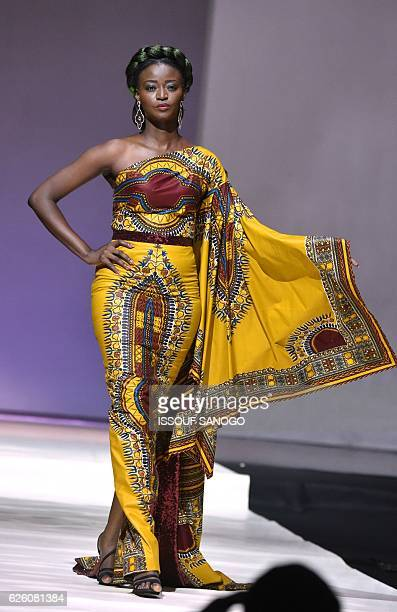 A model presents a creation by label Yioma during a fashion show marking the 170th anniversary of Dutch manufacturer of African luxury VLISCO in...