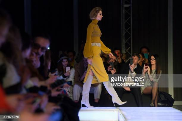 A model presents a creation by Les Copains during the women's Fall/Winter 2018/2019 collection fashion show in Milan on February 22 2018 / AFP PHOTO...