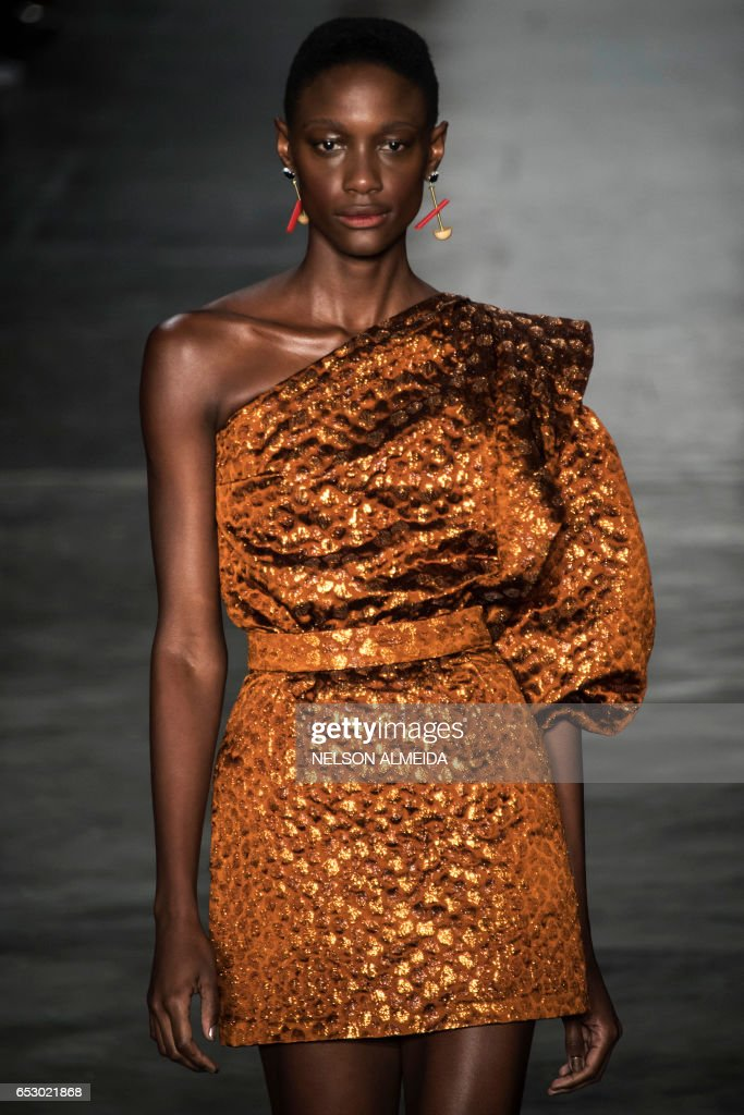 A model presents a creation by Lilly Sarti during the Sao Paulo Fashion Week in Sao Paulo, Brazil on March 13, 2017. /