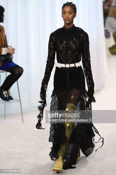 Model presents a creation by Loewe during the Women's Spring-Summer 2020 Ready-to-Wear collection fashion show in Paris, on September 27, 2019.