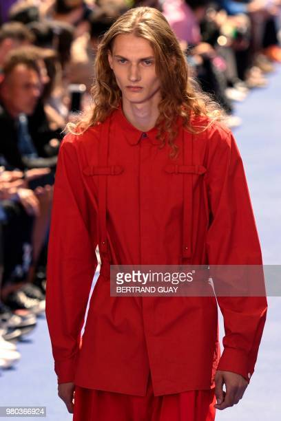 A model presents a creation by Louis Vuitton during the men's Spring/Summer 2019 collection fashion show on June 21 2018 in Paris