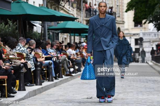 A model presents a creation by Louis Vuitton during the men's spring/summer 2020 fashion collection on June 20 2019 in Paris