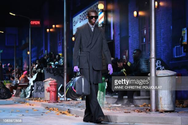 Model presents a creation by Louis Vuitton during the men's Fall/Winter 2019/2020 collection fashion show in Paris on January 17, 2019.