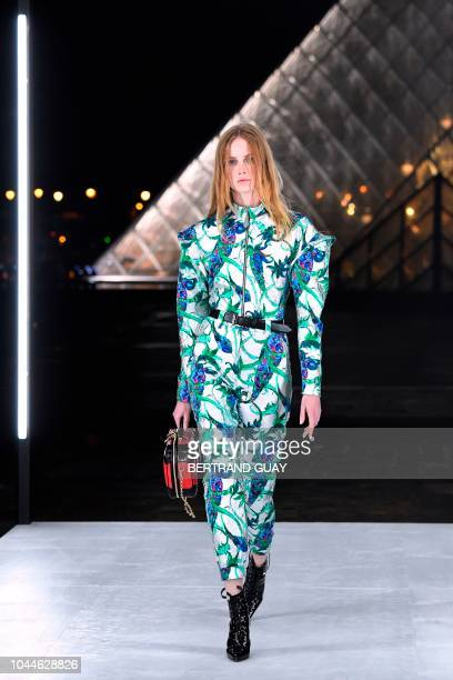 Model presents a creation by Louis Vuitton during the Spring-Summer 2019 Ready-to-Wear collection fashion show in Paris, on October 2, 2018.