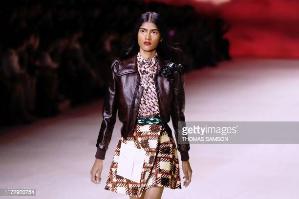 TOPSHOT A model presents a creation by Louis Vuitton during the Women's SpringSummer 2020 ReadytoWear collection fashion show at the Cour caree du...