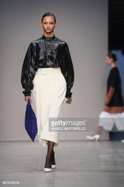 Model presents a creation by Lucio Vanotti during the women's Fall/Winter 2018/2019 collection fashion show in Milan, on February 21, 2018. / AFP...