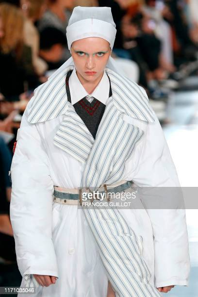 Model presents a creation by Maison Margiela during the Women's Spring-Summer 2020 Ready-to-Wear collection fashion show in Paris, on September 25,...