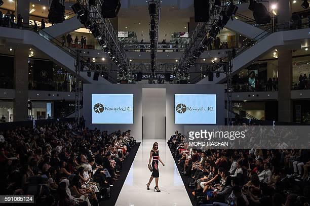 A model presents a creation by Malaysian designer Romyda KL during the 2016 Kuala Lumpur Fashion week on August 17 2016 / AFP / MOHD RASFAN