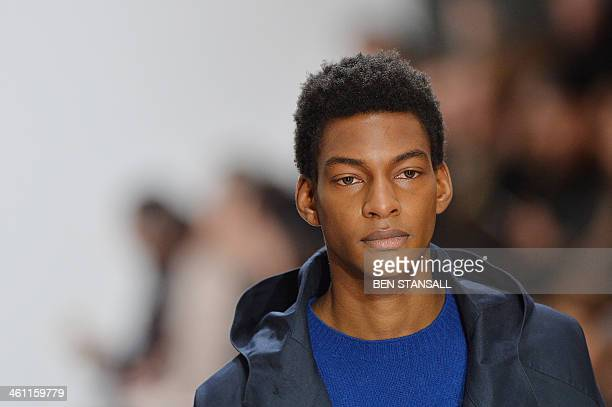 A model presents a creation by Margaret Howell during the Autumn/Winter 2014 London Collections Men's fashion event in London on January 7 2014 AFP...