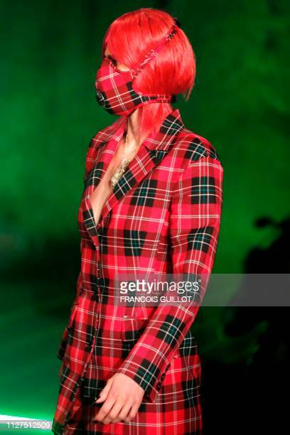 A model presents a creation by Marine Serre during the FallWinter 2019/2020 ReadytoWear collection fashion show in IssylesMoulineaux on the outskirts...