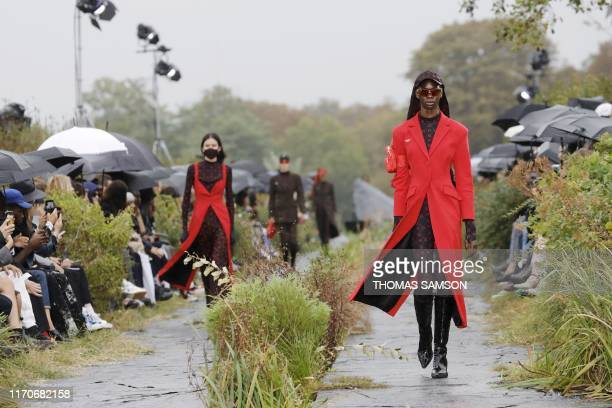 TOPSHOT A model presents a creation by Marine Serre during the Women's SpringSummer 2020 ReadytoWear collection fashion show in Paris on September 24...