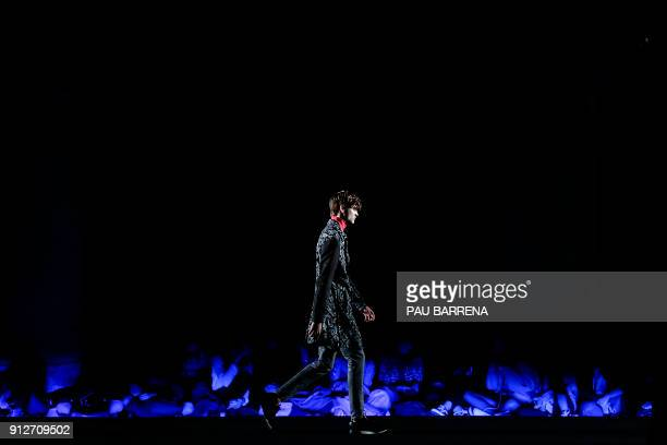 A model presents a creation by Miquel Suay during the 080 Barcelona Fashion Week in Barcelona on January 31 2018 / AFP PHOTO / PAU BARRENA