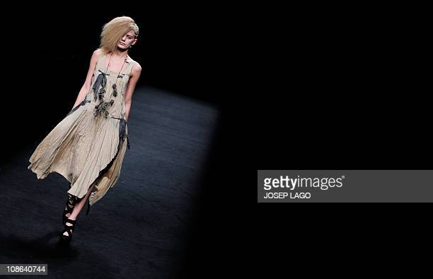 A model presents a creation by Mongolian designer Tsolmandakh Munkhuu during the 080 Barcelona fashion week on January 31 2011 in Barcelona AFP...