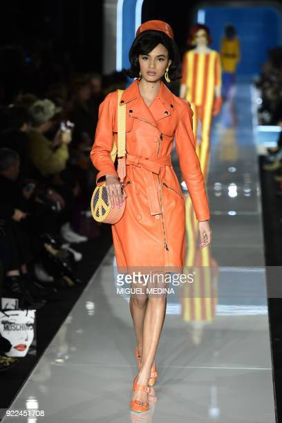 TOPSHOT A model presents a creation by Moschino during the women's Fall/Winter 2018/2019 collection fashion show in Milan on February 21 2018 / AFP...