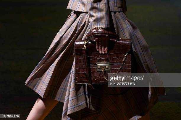 A model presents a creation by Mulberry during their 2017 Spring / Summer catwalk show at London Fashion Week in London England on September 18 2016...