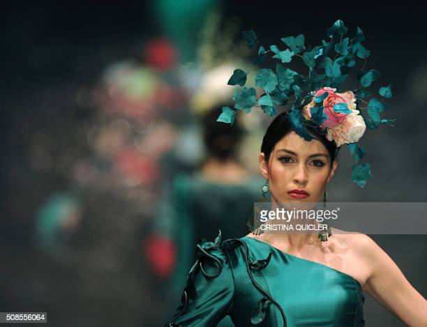A model presents a creation by new designer Cristina Granero during the SIMOF in Sevilla on February 5 2016 AFP PHOTO/ CRISTINA QUICLER / AFP /...