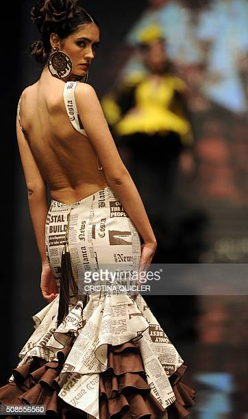 A model presents a creation by new designer Sergy Garrido during the SIMOF in Sevilla on February 5 2016 AFP PHOTO/ CRISTINA QUICLER / AFP / CRISTINA...