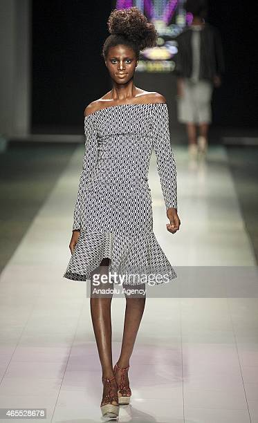 A model presents a creation by NN Vintage during the Mercedes Benz Fashion Week in Johannesburg South Africa on March 7 2015