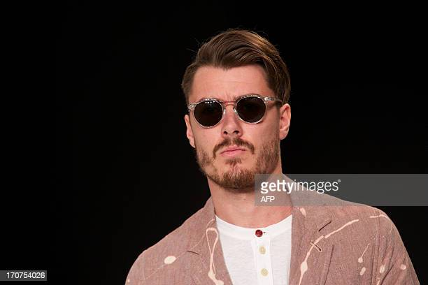 Model presents a creation by Oliver Spencer during the Spring/Summer 2014 London Collections: Men fashion event in London on June 17, 2013. AFP...