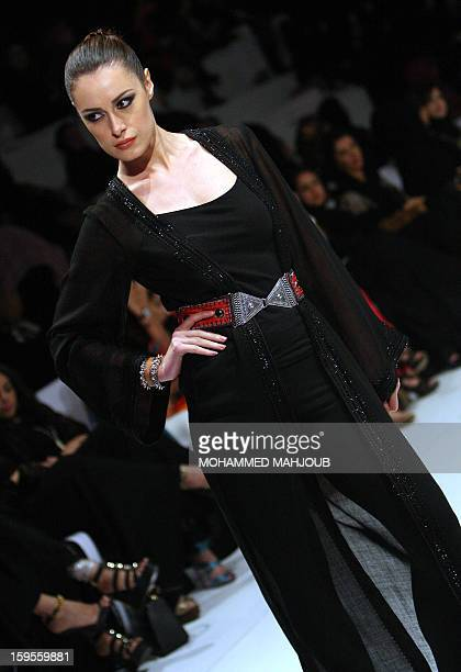 A model presents a creation by Omani designer Nawal alHooti during the 2013 Muscat Fashion Week in the Omani capital late on January 15 2013 AFP...