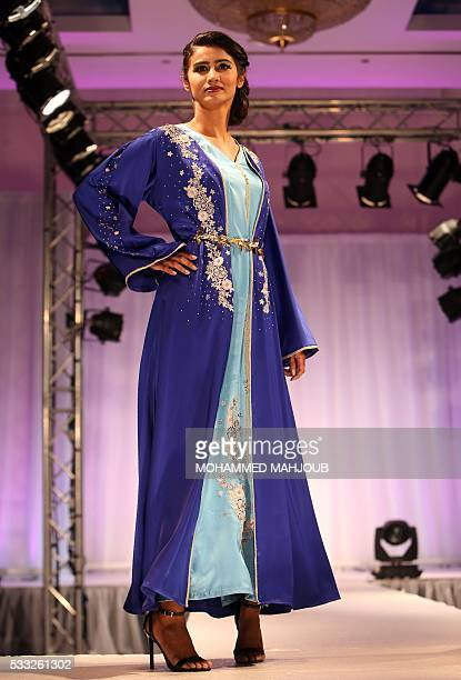 A model presents a creation by Omani fashion designer Hala alMaamari during the Omani Women's Fashion Trends event on May 21 in the capital Muscat /...