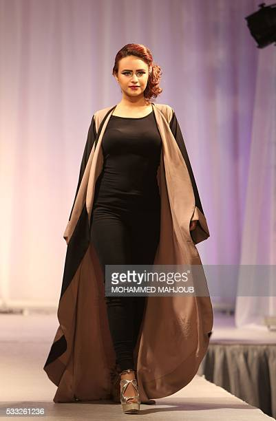 A model presents a creation by Omani fashion designer Huda alSabbagh during the Omani Women's Fashion Trends event on May 21 in the capital Muscat /...