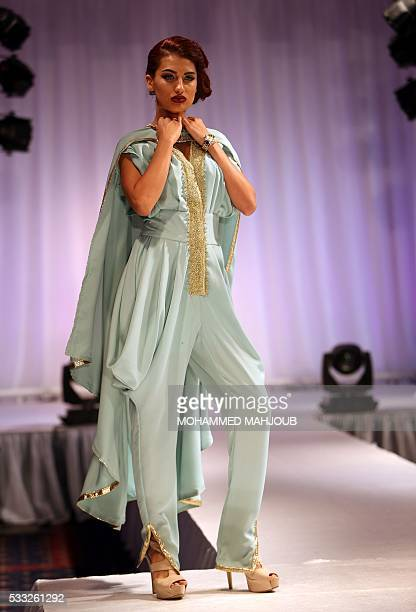 A model presents a creation by Omani fashion designer Salha alFarsi during the Omani Women's Fashion Trends event on May 21 in the capital Muscat /...