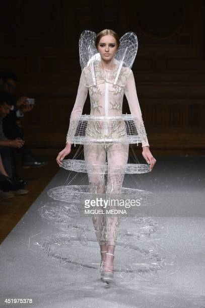 A model presents a creation by Oscar Carvallo during the 2014/2015 Couture FallWinter collection fashion show on July 10 2014 in Paris AFP PHOTO /...