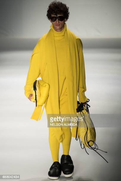 Model presents a creation by Osklen during the Sao Paulo Fashion Week in Sao Paulo, Brazil on March 13, 2017. / AFP PHOTO / NELSON ALMEIDA