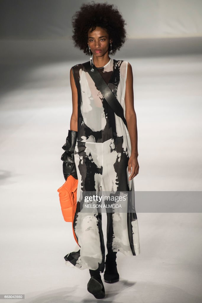 A model presents a creation by Osklen during the Sao Paulo Fashion Week in Sao Paulo, Brazil on March 13, 2017