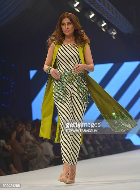 A model presents a creation by Pakistani designer Aamna Aqeel on the final day of the Fashion Pakistan Week in Karachi on April 9 2016 / AFP / RIZWAN...