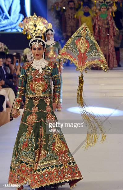 A model presents a creation by Pakistani designer Ali Xeeshan on the first day of the Pakistan Fashion Design Council L'Oreal Paris Bridal Week in...