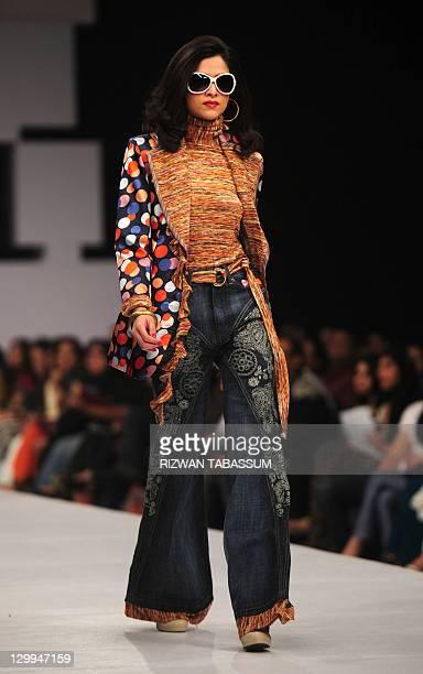 A model presents a creation by Pakistani designer Ammar Belal during the PFDC Sunsilk Fashion Week in Karachi on October 22 2011 AFP PHOTO/ RIZWAN...