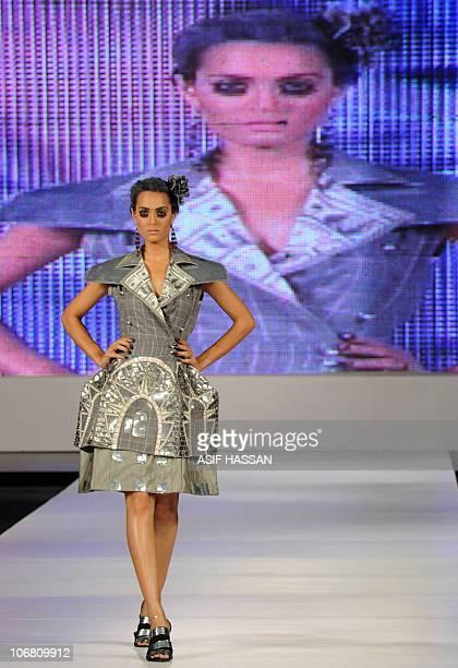A model presents a creation by Pakistani designer Ammar Belal on the last day of the Pakistan Fashion Design Council Sunsilk Fashion Week in Karachi...