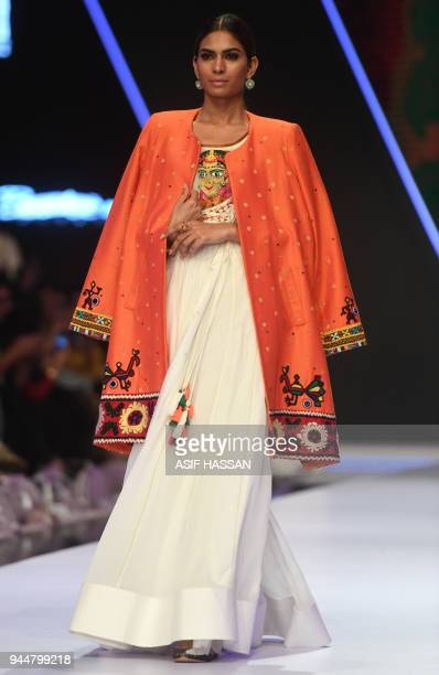 A model presents a creation by Pakistani designer Bohemi Kanwal on the final day of the Fashion Pakistan Week Spring/Summer 2018 in Karachi on April...