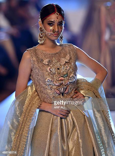 A model presents a creation by Pakistani designer Fahad Hussayn on the second day of the Pakistan Fashion Design Council L'Oreal Paris Bridal Week in...