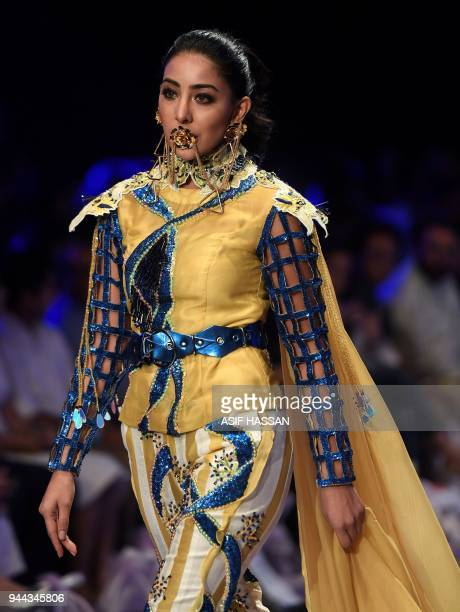 A model presents a creation by Pakistani designer Hassan Riaz on the first day of the Fashion Pakistan Week in Karachi on April 10 2018 / AFP PHOTO /...