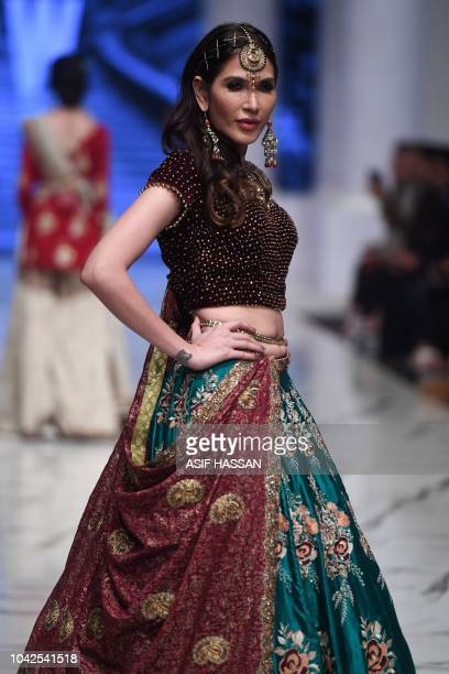 A model presents a creation by Pakistani designer Huma Adnan on the first day of the Fashion Pakistan Week in Karachi on September 28 2018