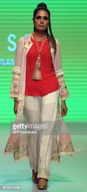 A model presents a creation by Pakistani designer Huma Adnan on the first day of the Made In Pakistan Fashion Showcase 2017 in Karachi on November 10...