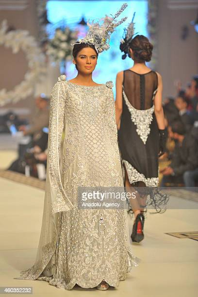 Model presents a creation by Pakistani designer MariaB on first day of Bridal Couture Fashion Week in Lahore Pakistan on December 11 2014
